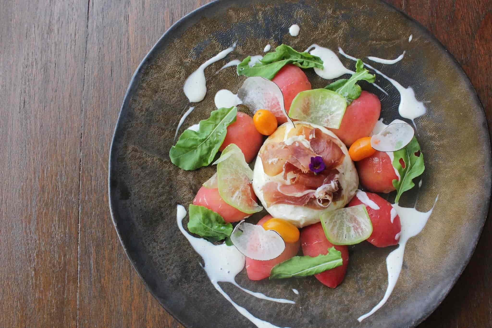burrata with parma ham and rocket salad